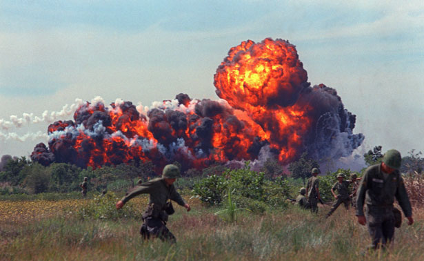 A-napalm-strike-erupts-in-a-fireball-near-US-troops-on-patrol-in-South-Vietnam-1966-during-the-Vietnam-War.-AP-Photo