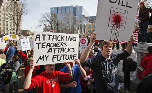 "The University of Wisconsin–Madison's Teaching Assistants' Association TAA called for a ""teach out"" Thursday, asking for all activity to cease on campus so that the university could stand as unified front against the bill.