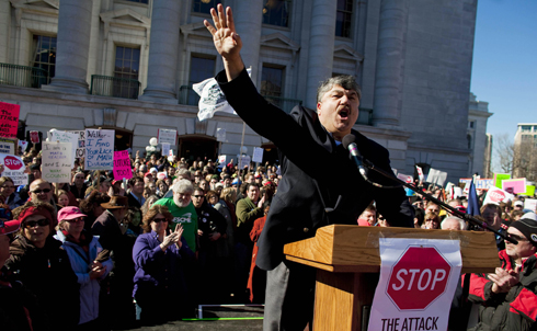 The fight in Wisconsin could be coming to your state soon. Stop the right's attack on unions in its tracks by joining Wisconsin demonstrators in a virtual march. The signatures will be delivered to Democratic leaders in the target states. And if you're a Wisconsin voter you can sign this petition pledging to support a recall of any and all State Senators supporting Walker's bill.