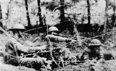 """With American soldiers returning from the bloody trenches and fields of World War I Europe, The Nation's James Rorty asks whether the ravages of the front have laid waste to the men's futures: """"War kills the spirit as well as the flesh of youth. Are they spent, or have they still to give? To these men as they march past, shall we say 'Hail'—or 'Farewell'?""""  AP Images"""