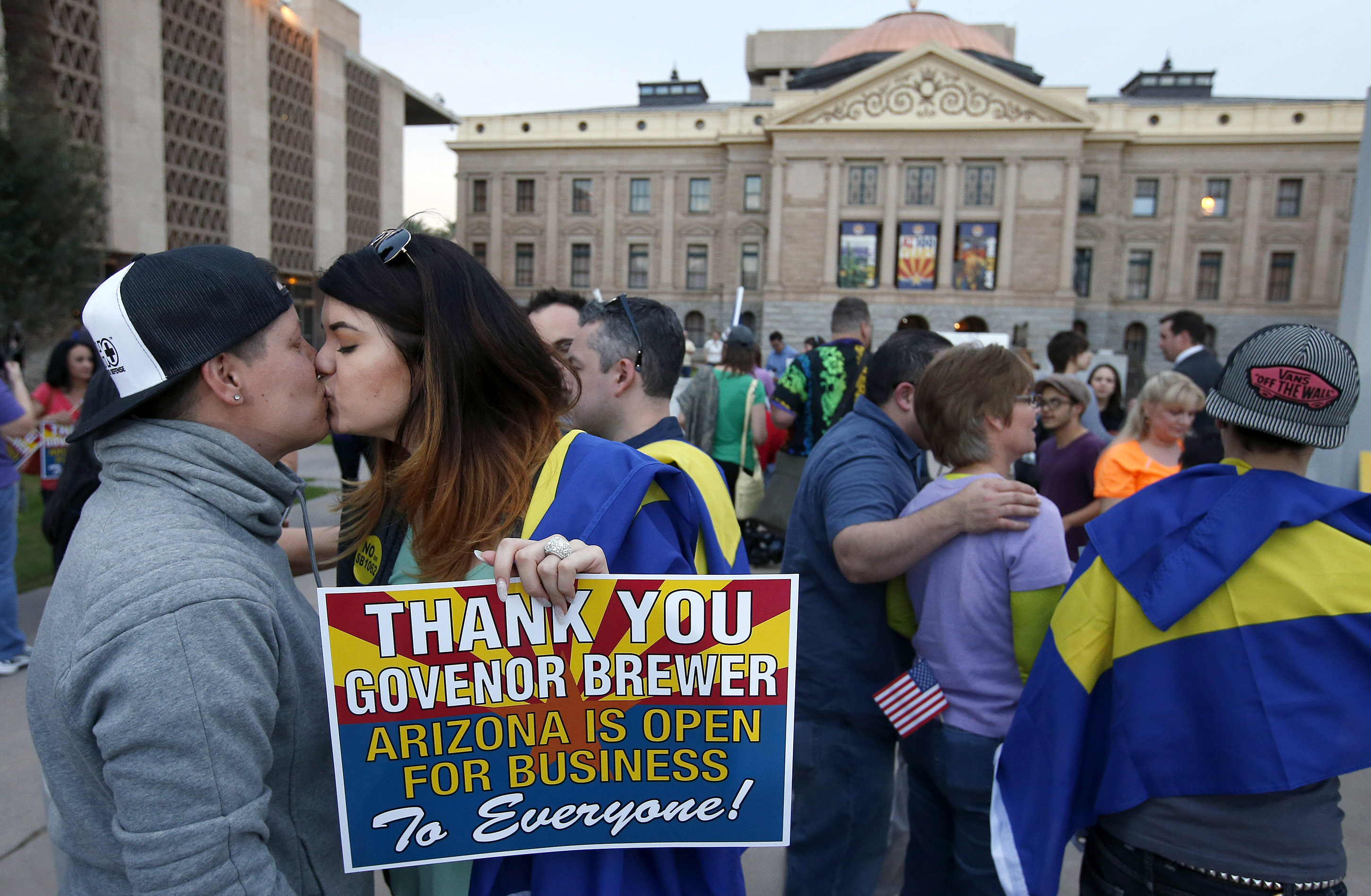 A-couple-kisses-after-learning-that-Arizona-Gov.-Jan-Brewer-announces-vetoed-SB1062-which-wouldve-granted-businesses-the-right-to-refuse-service-to-LGBTQ-people.-AP-PhotoRoss-D.-Franklin