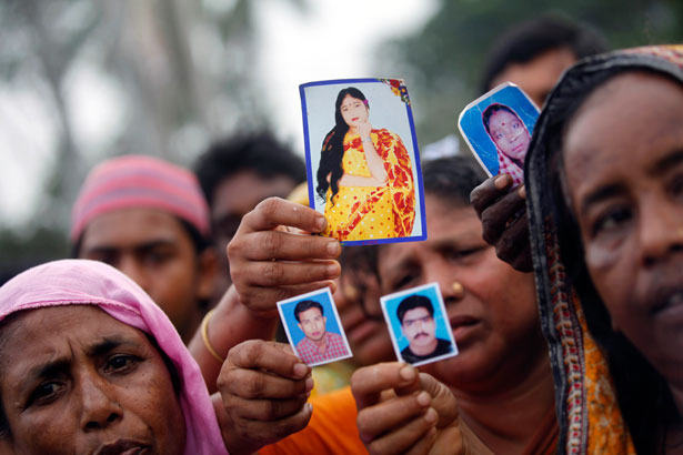 pemRelatives-show-pictures-of-garment-workers-who-died-or-went-missing-after-the-disaster-at-Rana-Plaza.-ReutersAndrew-Birajemp