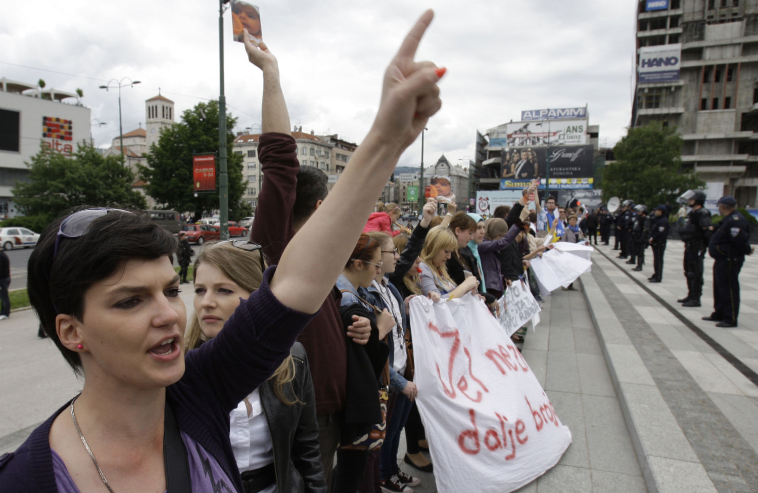 Protesters-form-a-human-chain-outside-their-parliament-building-in-Sarajevo.-APAmel-Emric