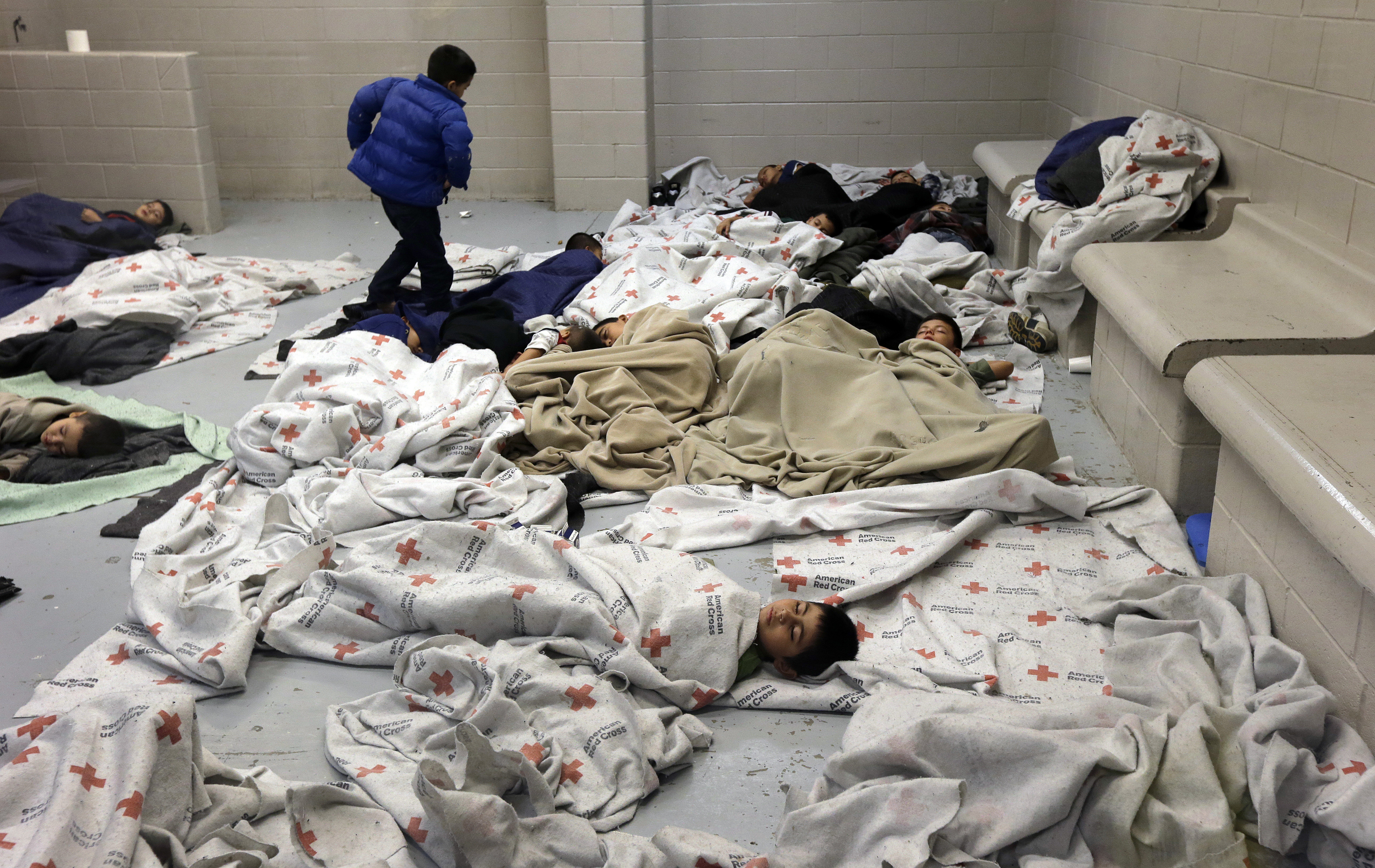 pemChild-detainees-sleep-in-a-holding-cell-at-a-US-Customs-and-Border-Protection-processing-facility-in-Brownsville-Texas.-ReutersEric-GayPoolemp
