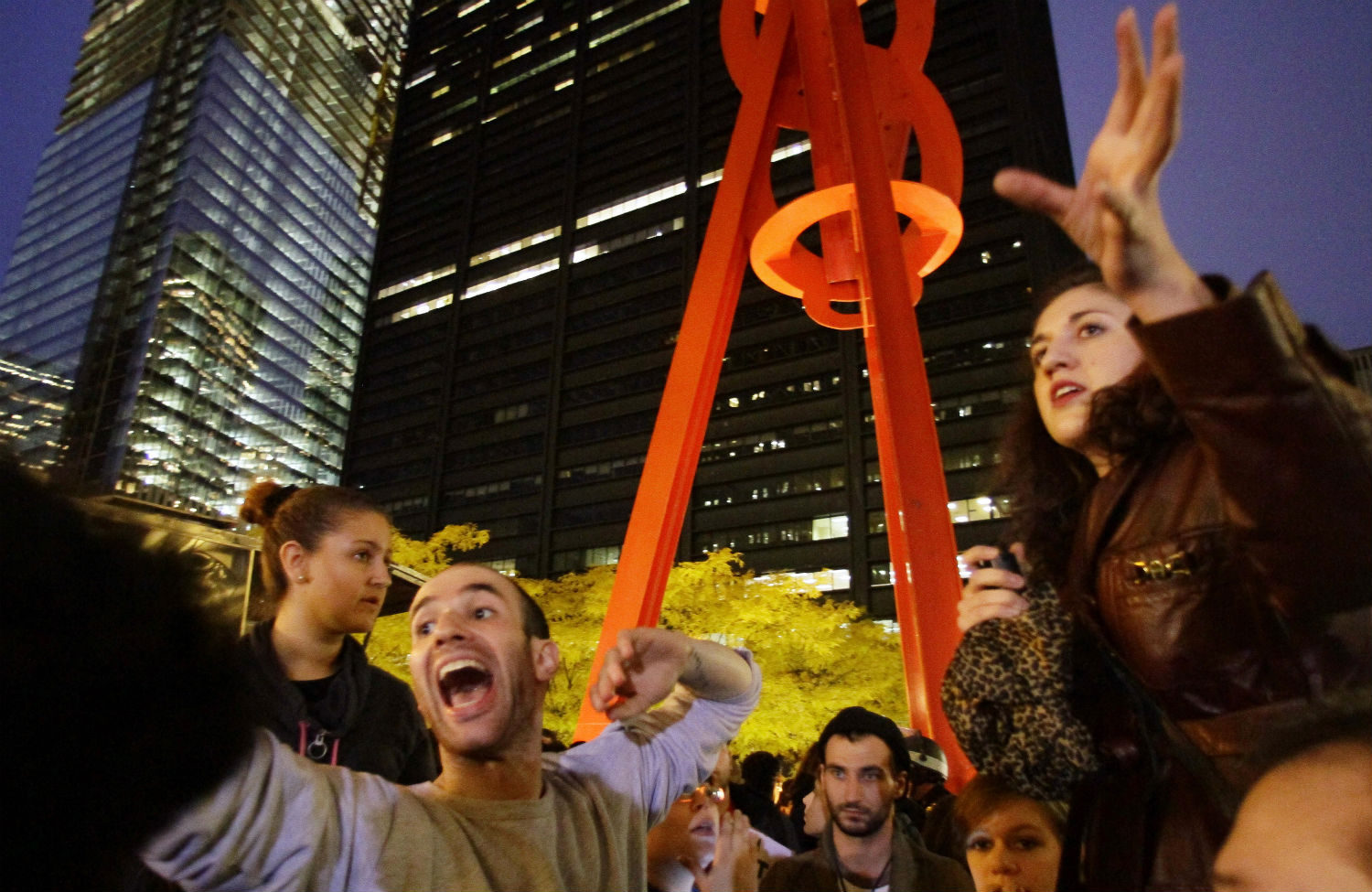 Occupy-Wall-Street-protesters-Eric-Linkser-and-Cecily-McMillan-take-turns-shouting-information-to-protesters