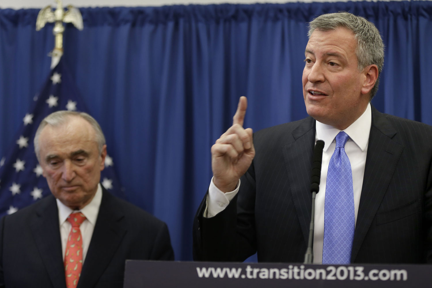 William-Bratton-left-listens-while-New-York-Mayor-elect-Bill-de-Blasio-talks-during-a-news-conference-in-New-York-Thursday.-AP-Photo