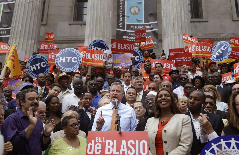 Mayor-Bill-de-Blasio-center-spoke-at-a-union-rally-in-Brooklyn-during-his-campaign.-AP-PhotoSeth-Wenig