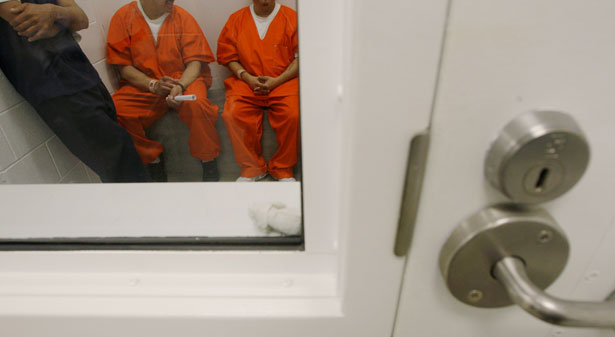 Detainees-inside-a-holding-cell-at-the-Northwest-Detention-Center-in-Tacoma-Washington.-The-facility-houses-people-whose-immigration-status-is-in-question-or-who-are-waiting-for-deportation-or-deportation-hearings.-AP-PhotoTed-S.-Warren