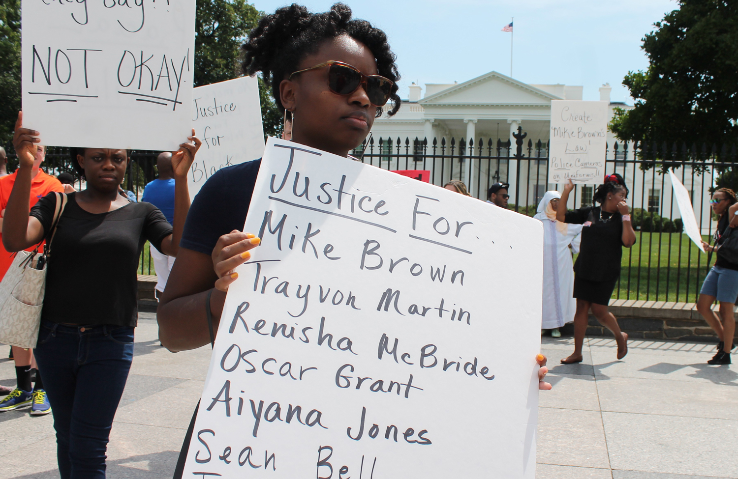 A-woman-protests-police-brutality-in-the-wake-of-Mike-Browns-death