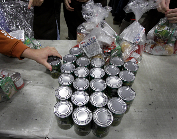 Volunteers-fill-bags-with-food-for-part-of-their-backpack-school-lunch-program-AP-PhotoAmy-Sancetta