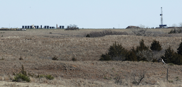 pIn-this-2012-photo-an-oil-drilling-rig-drill-into-the-Gypsum-Hills-near-Medicine-Lodge-Kan.-An-emerging-oil-boom-has-been-sparked-by-modern-technologies-using-horizontal-drilling-and-a-technique-known-as-hydraulic-fracturing-or-ldquofrackingrdquo-to-coax-out-oil-and-gas.-AP-Photo-Orlin-Wagnerp