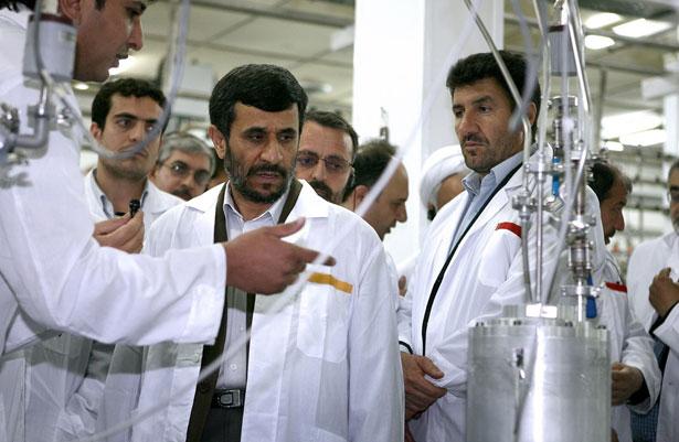 Former-Iranian-President-Mahmoud-Ahmadinejad-center-listens-to-a-technician-during-his-visit-of-the-Natanz-Uranium-Enrichment-Facility.-AP-Photo