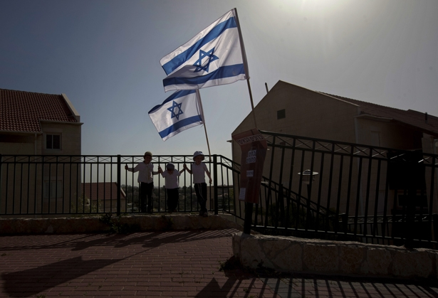 Israeli-flags-fly-over-the-Ulpana-neighborhood-in-the-West-Bank