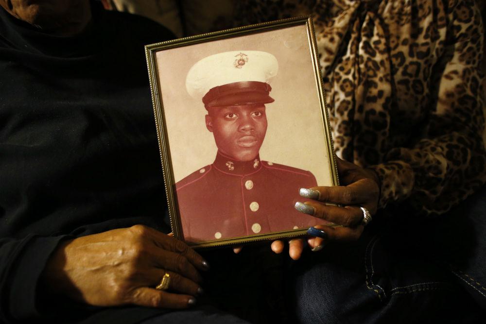 pemA-picture-of-Jerome-Murdough-is-held-by-his-mother-Alma-Murdough.-AP-PhotoJason-DeCrowemp