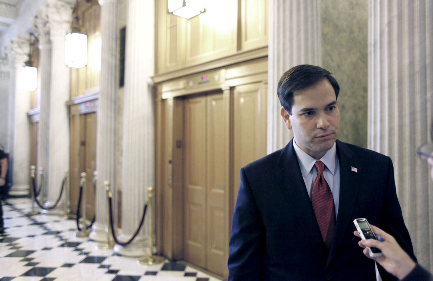 Marco-Rubio-speaks-with-a-reporter-outside-of-the-Senate-Chamber-on-Capitol-Hill.-AP-PhotoHarry-Hamburg
