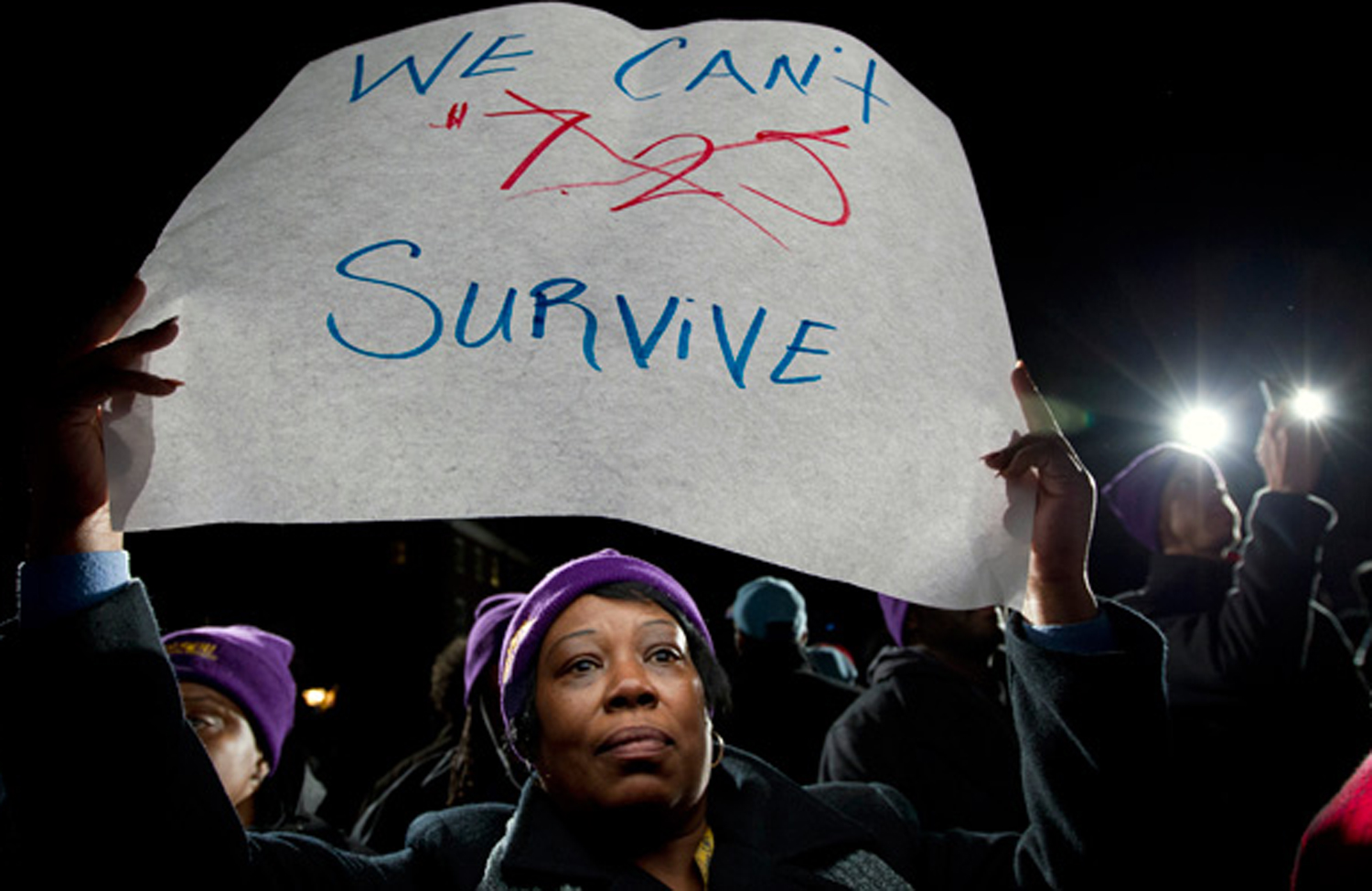 A-protester-at-a-rally-to-support-raising-the-minimum-wage-in-Maryland