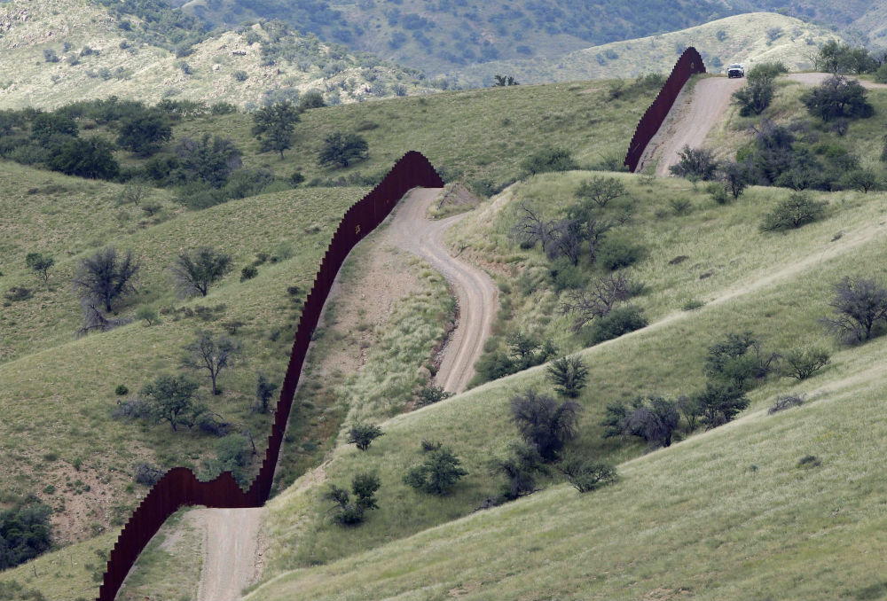 pThe-international-border-fence-near-Nogales-Arizona-AP-ImagesMatt-Yorkp