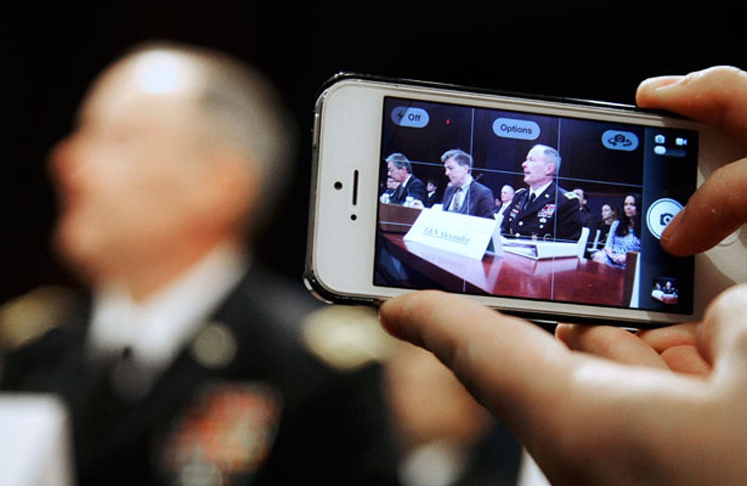 A-reporter-takes-a-mobile-phone-picture-of-National-Security-Agency-NSA-Director-U.S.-Army-General-Keith-Alexander