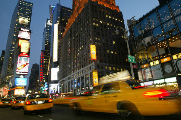 Taxicabs-speed-down-Broadway-in-New-York