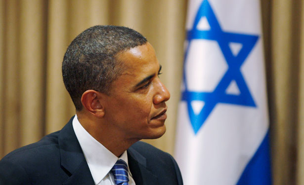 Then-US-Democratic-presidential-hopeful-Sen.-Barack-Obama-D-Ill-listens-to-Israels-President-Shimon-Peres-not-seen-during-a-meeting-in-Jerusalem.-AP-Photo