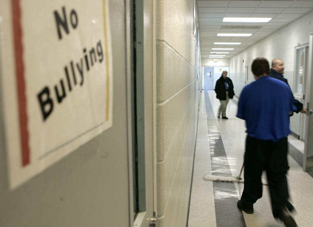 pemA-juvenile-offender-mops-the-floor-during-his-work-program-at-Circleville-Youth-Center-in-Ohio.-AP-PhotoKiichiro-Satoemp