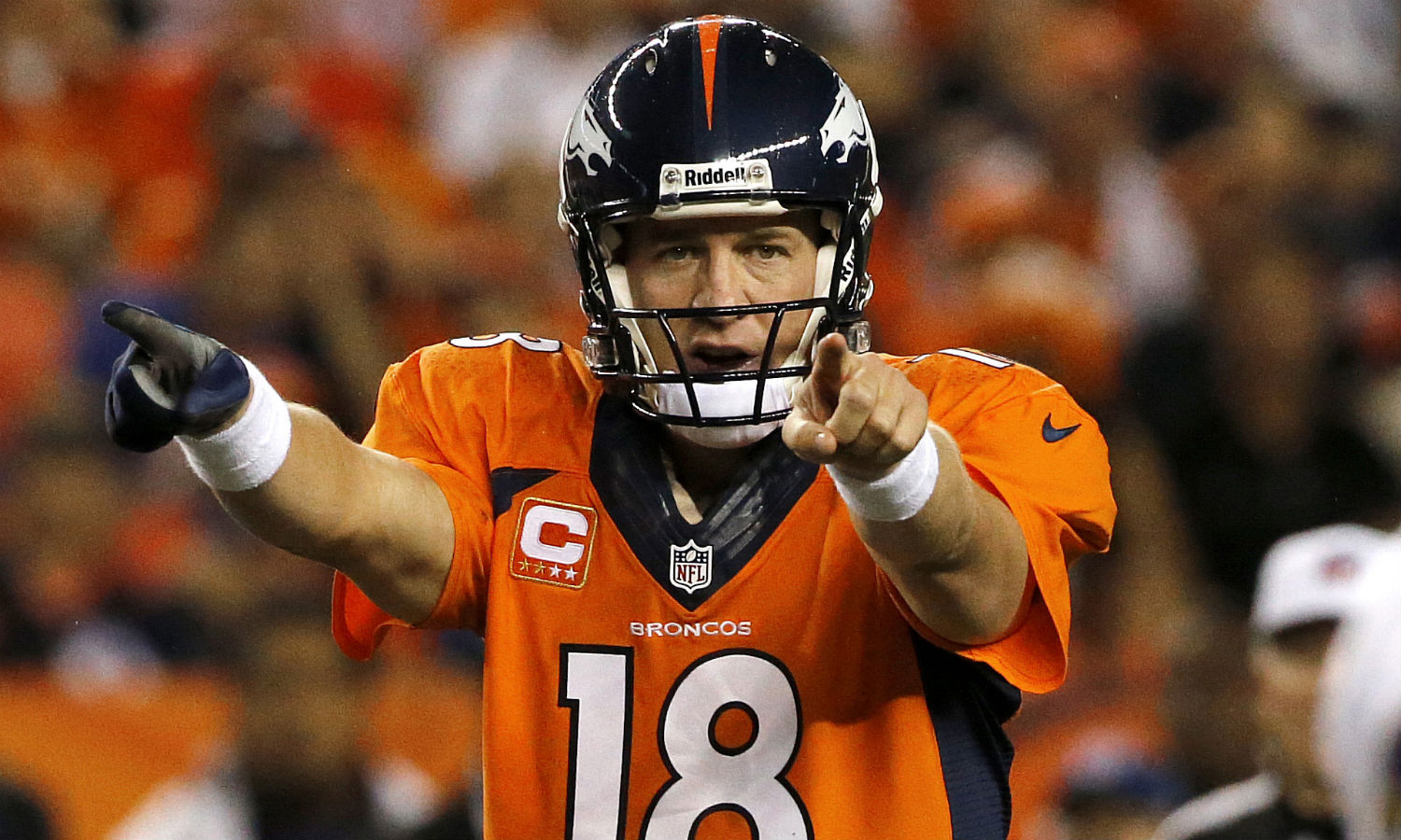 Peyton-Manning-18-calls-a-play-at-the-line-of-scrimmage-during-the-first-half-of-an-NFL-football-game-against-the-Baltimore-Ravens-in-Denver.-AP-Photo