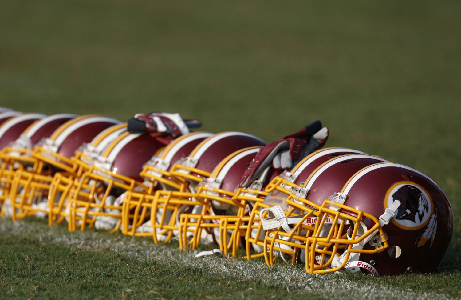pWashington-Redkins-helmets-displaying-their-emblematic-colors-and-team-mascot.p