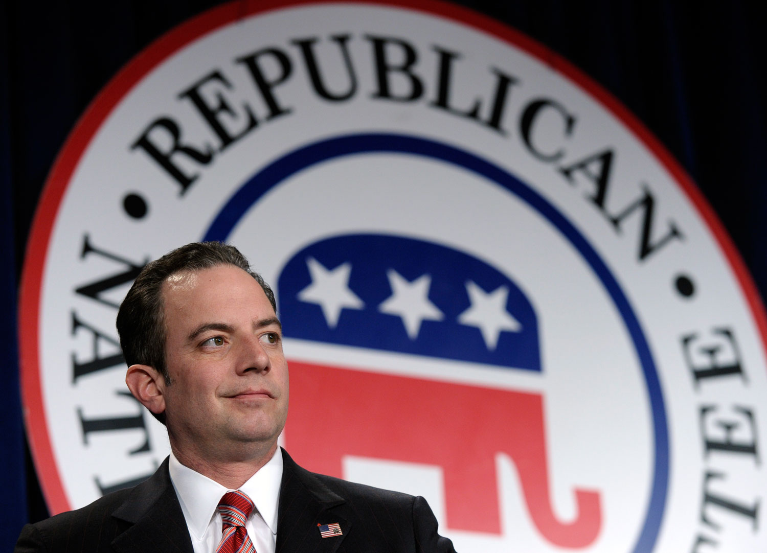 pemRNC-Chairman-Reince-Priebus-stands-on-stage-at-an-annual-winter-meeting-in-Washington-Friday-Jan.-24-2014.-AP-PhotoSusan-Walshemp