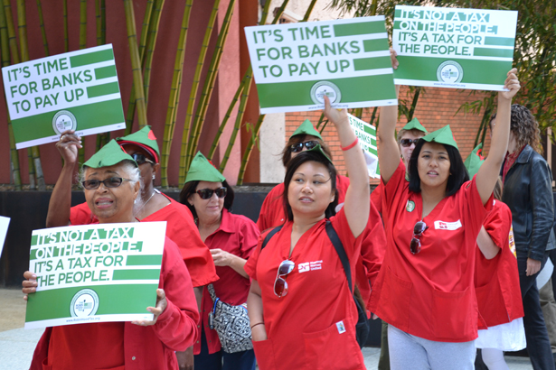 Members-of-National-Nurses-United-demonstrate-in-support-of-the-Robin-Hood-Tax