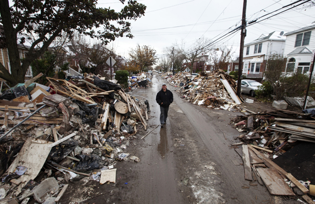 pA-man-walks-through-piles-of-debris-left-by-Hurricane-Sandy-in-Belle-Harbor-Queens.-Reuters-Lucas-Jacksonnbspp