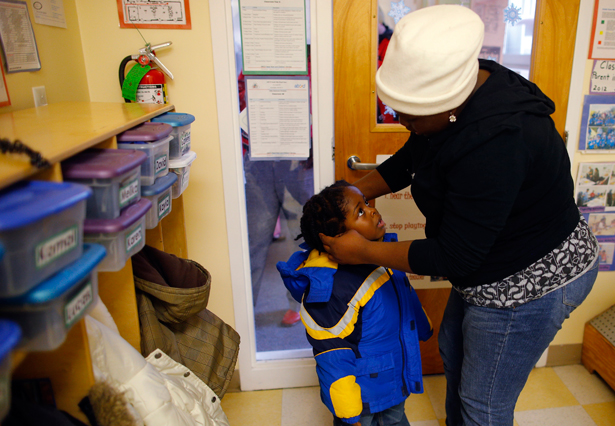 A-mother-picks-up-her-child-at-a-Head-Start-program-in-Boston