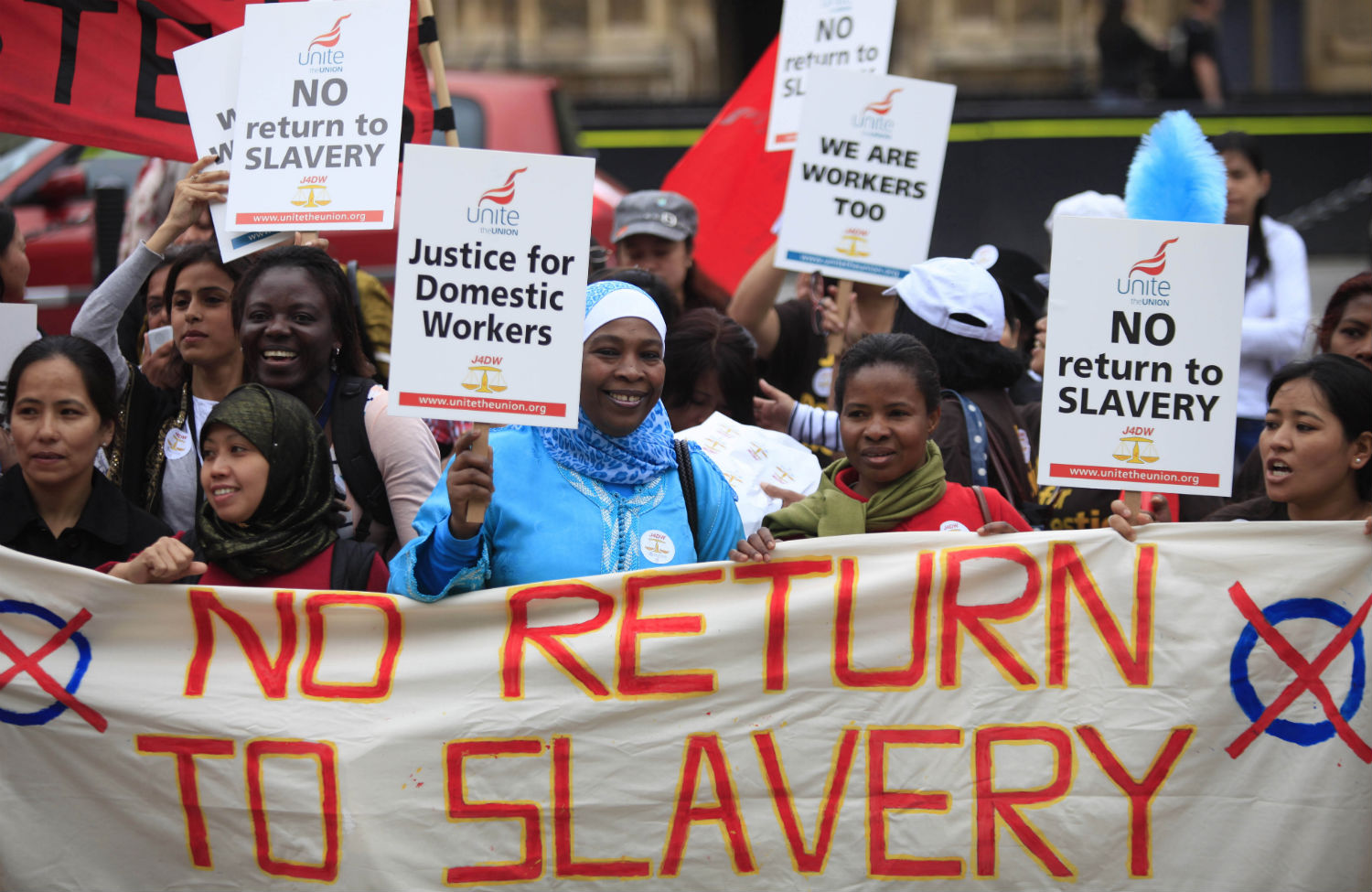 Migrant-workers-gather-for-a-rally-across-from-the-Houses-of-Parliament