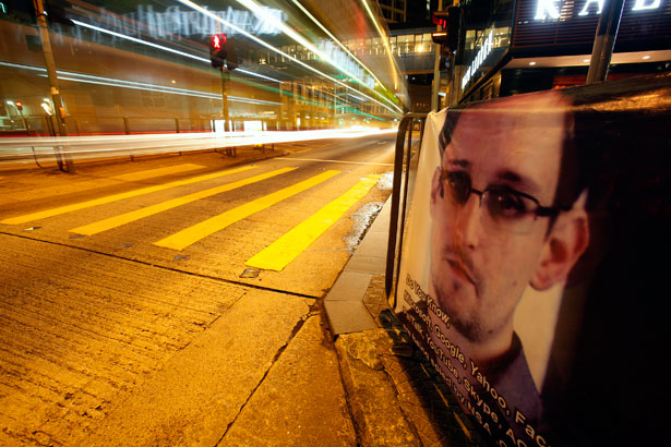A-bus-passes-by-a-poster-of-Edward-Snowden-a-former-contractor-at-the-National-Security-Agency-NSA.-Reuters