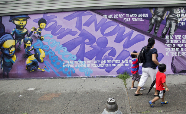 pemA-woman-and-children-walk-past-a-street-mural-in-New-York.-APBebeto-Matthewemp