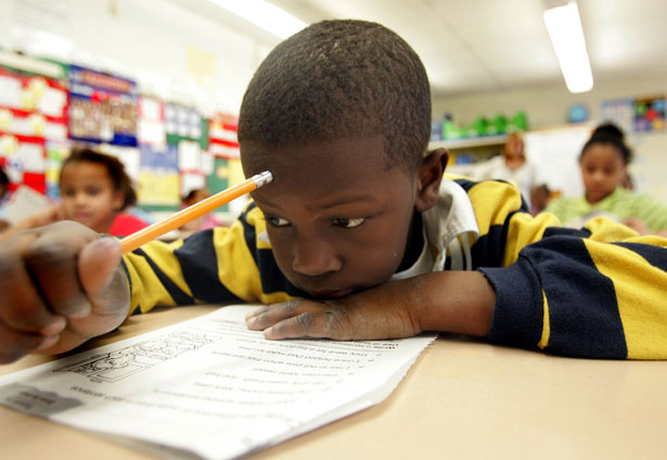 Second-grade-student-reads-in-preparation-for-a-test.-AP-Photo-Jose-F.-Moreno