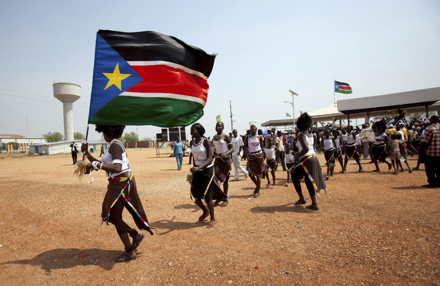 The lesson of carving up sudan the nation southern sudanese citizens hold their flag and chant slogans as they march in the streets in support of the independence referendum in juba south sudan sciox Images