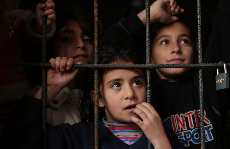pSyrian-refugeesp