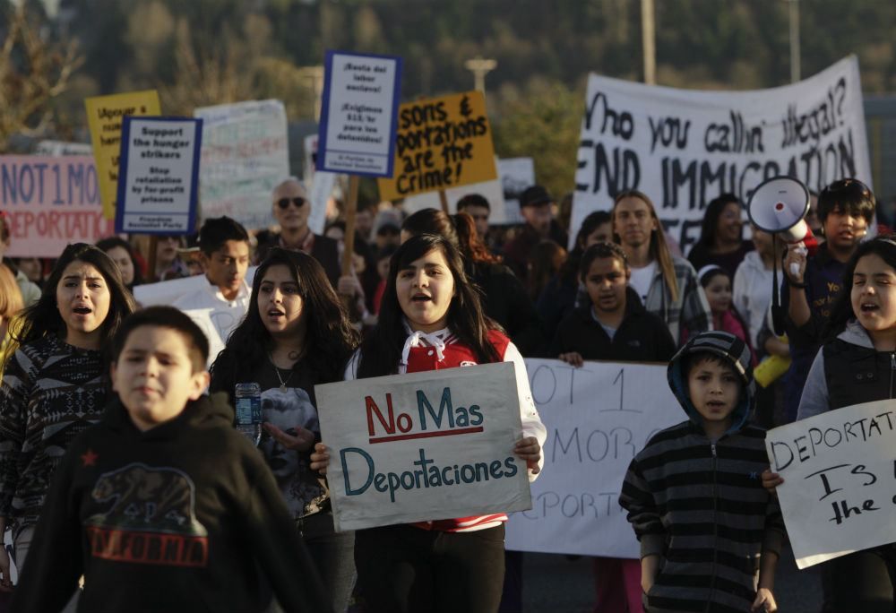 pemActivists-rally-outside-the-ICE-Northwest-Detention-Center-in-Tacoma-Washington-on-March-11-2014.-ReutersJason-Redmondemp
