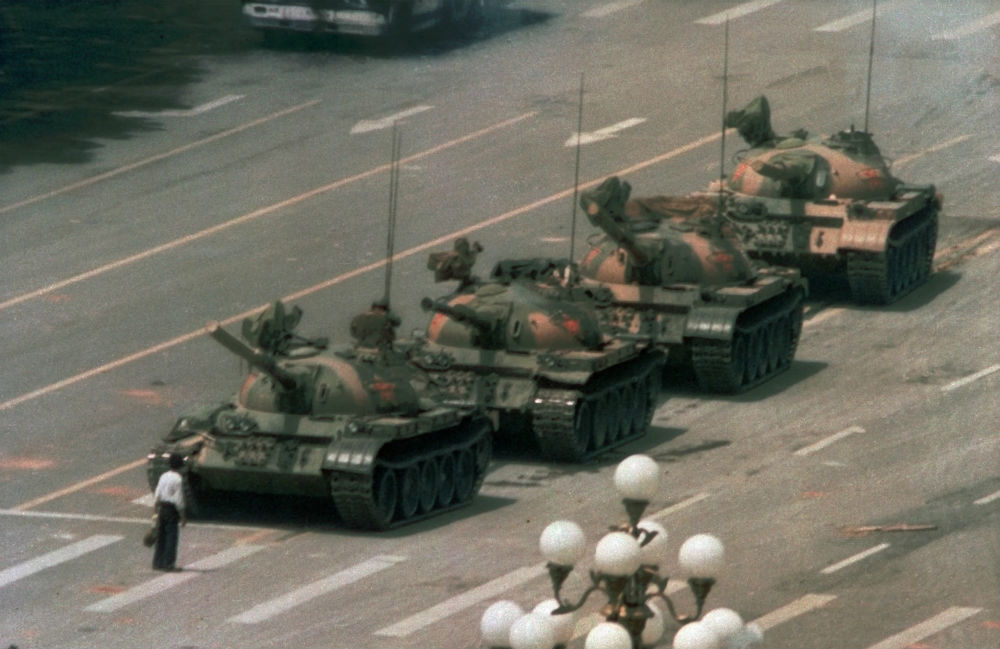 A-Chinese-man-stands-alone-to-block-a-line-of-tanks-heading-east-on-Beijings-Cangan-Blvd.-in-Tiananmen-Square-on-June-5-1989.-AP-PhotoJeff-Widener