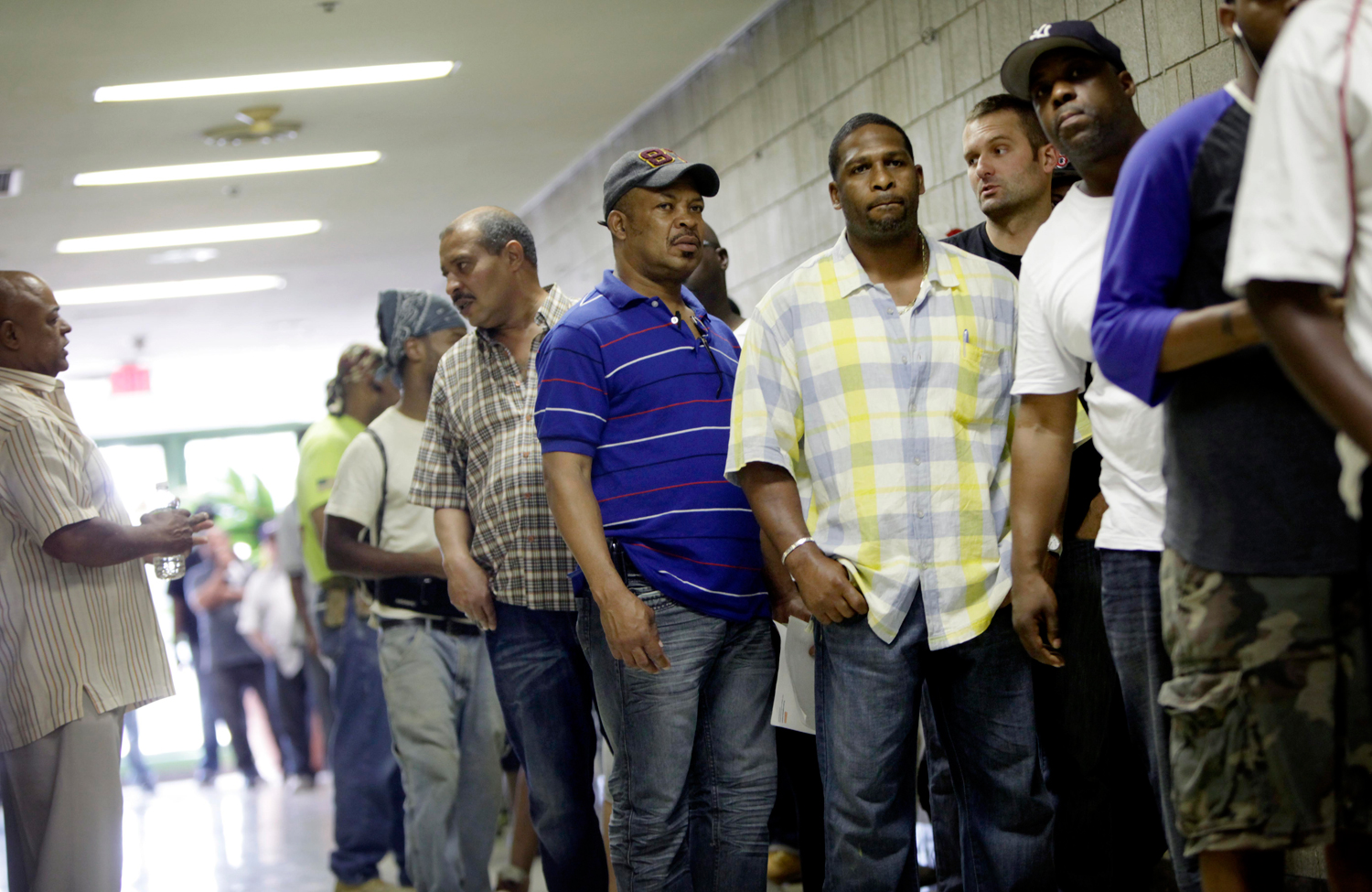 Men-wait-in-line-to-a-apply-for-jobs