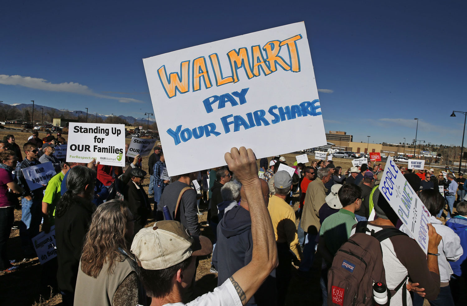 Colorado-Walmart-employees-and-supporters-protest-in-front-of-a-Walmart-store-in-Lakewood-Colo.-Friday-Nov.-29-2013.-AP-PhotoBrennan-Linsley