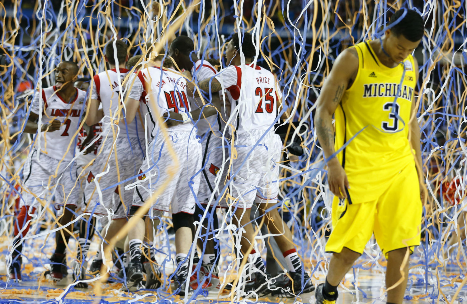 an economist explains why college athletes should be paid the nation michigan wolverines guard trey burke right walks off the court after losing to the louisville cardinals in the 2013 championship game