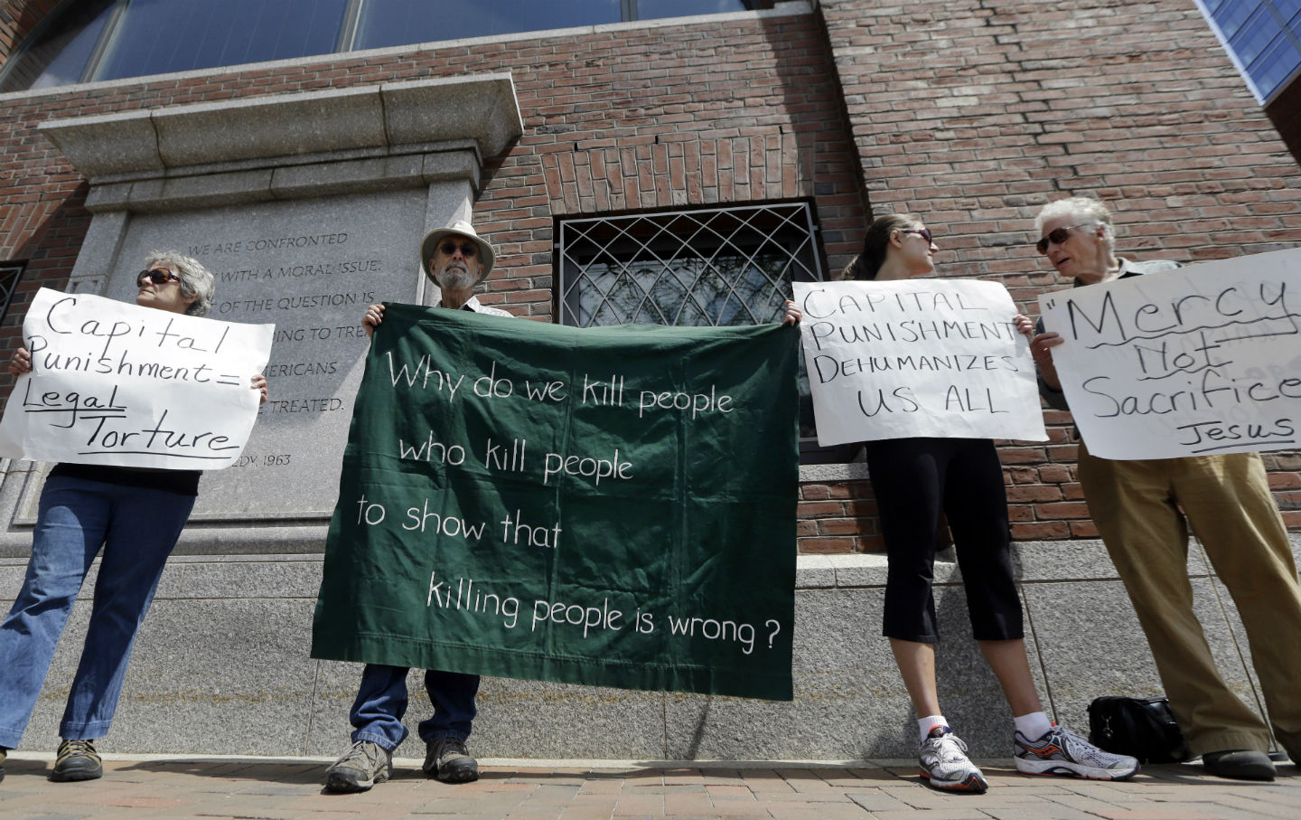 Demonstrators protest the death penalty for Dzhokhar Tsarnaev.