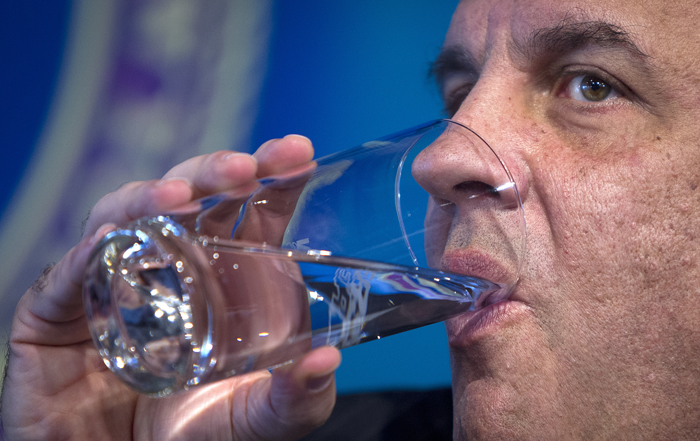 Chris Christie drinks water