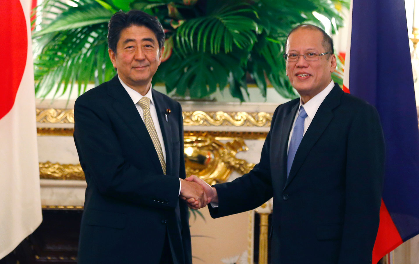 What the class politics of world war ii mean for tensions in asia philippine president benigno aquino iii right shakes hands with japanese prime minister shinzo abe prior to their meeting at akasaka palace state guest publicscrutiny Images