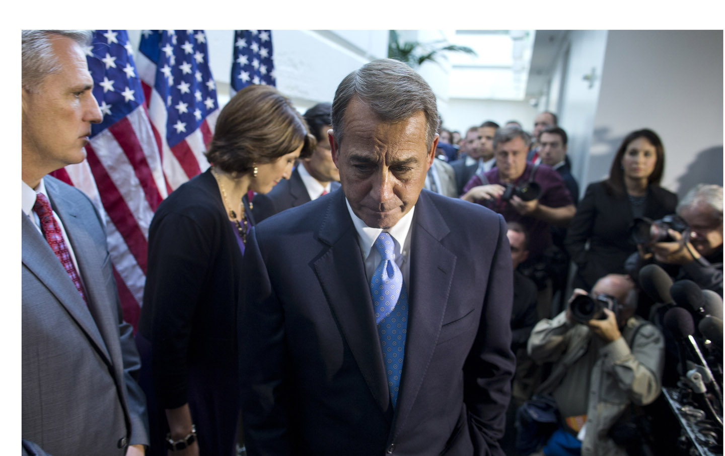 Speaker of the House Rep. John Boehner, R-Ohio, walks away from the microphone during a news conference
