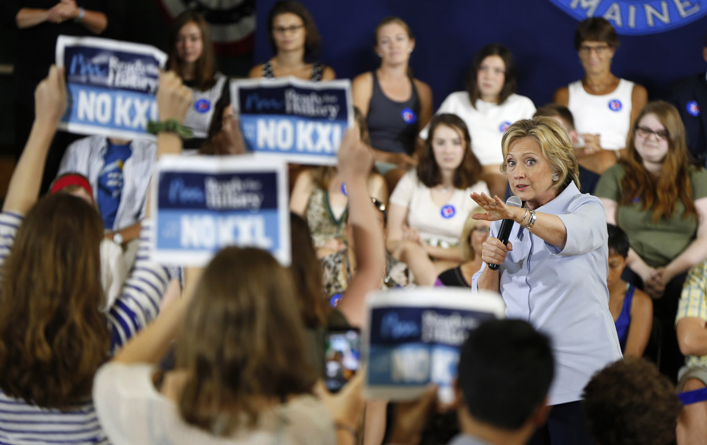 Hillary Clinton asks a group opposing the Keystone pipeline to stop disrupting her campaign event in Portland, Maine