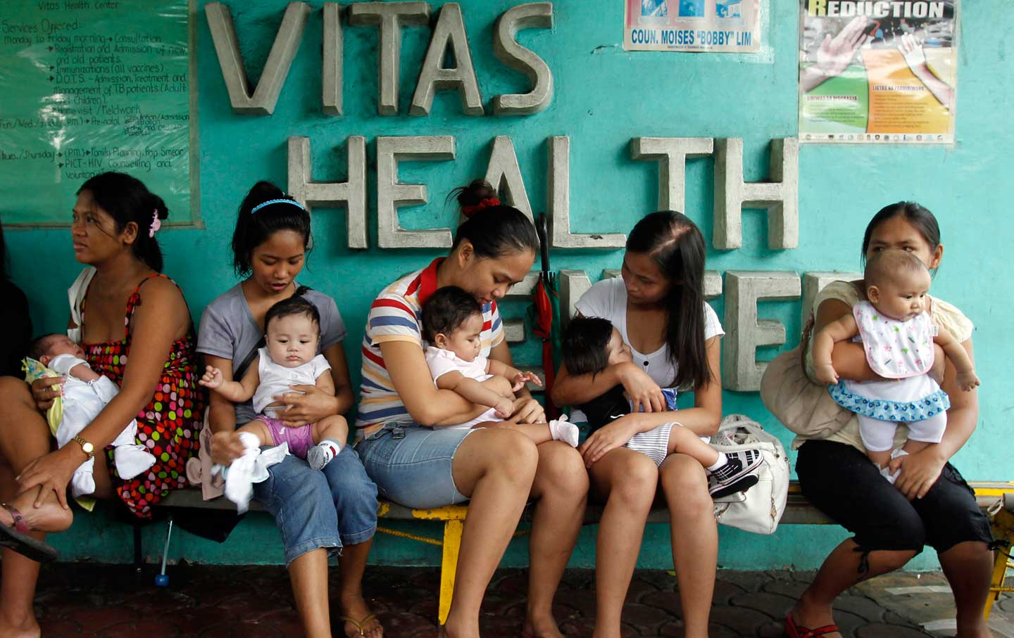 Young mothers at a health clinic in Manila. In 2012, the Catholic Church opposed a bill guaranteeing access to birth control and sex education in the Philippines. Credit: Erik de Castro / Reuters