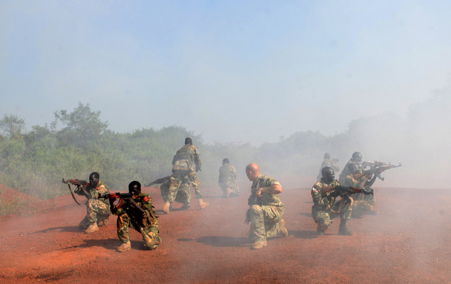 A U.S. Special Forces trainer supervises a military assault drill for a unit within the Sudan People's Liberation Army conducted in Nzara on the outskirts of Yambio