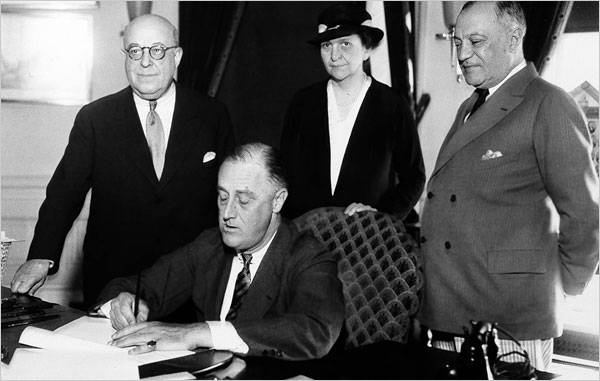 Franklin Roosevelt signs the National Labor Relations Act of 1935.